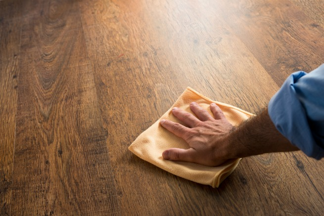 An Image Of Someone Cleaning A Wooden Floor