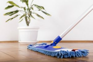 An image showing somebody clean the floors with a mop