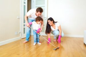 Image of family using mop as best cleaner for laminate floor