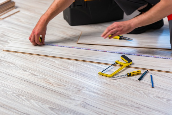 image of man cutting floorboards