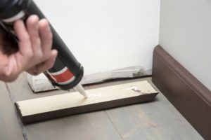 Image of someone fitting skirting boards