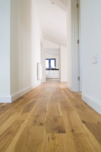An image of a hallway with solid wood