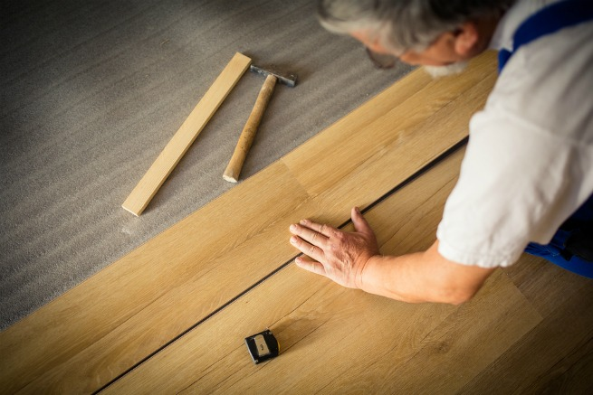 An image of a man installing laminate