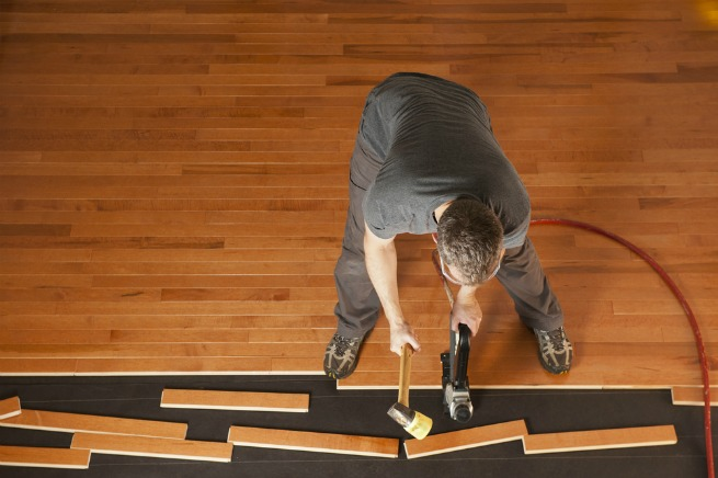 Image of a man fitting a floor
