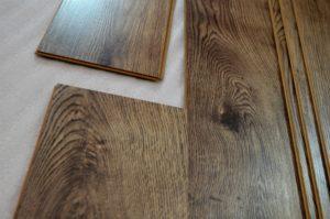 An image showing someone installing laminate flooring