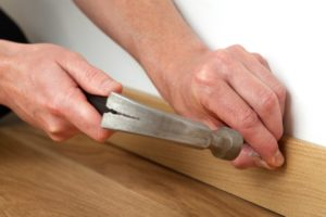 image of someone nailing skirting boards