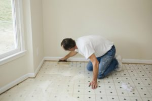 Image showing a man laying a subfloor
