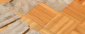 An image showing someone removing laminate flooring