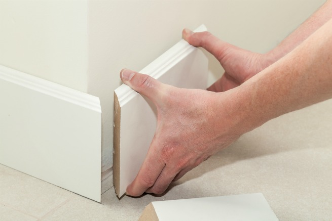 Image of somebody fitting skirting boards