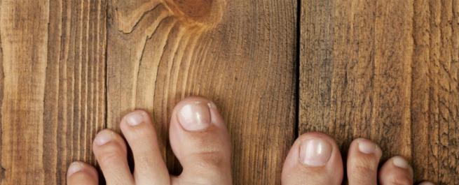 Image of feet on wood floor