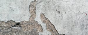 An image of a cracked concrete floor