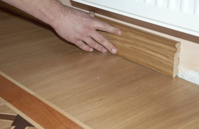 An image of someone installing skirting