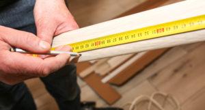 Measuring wood when installing laminate flooring