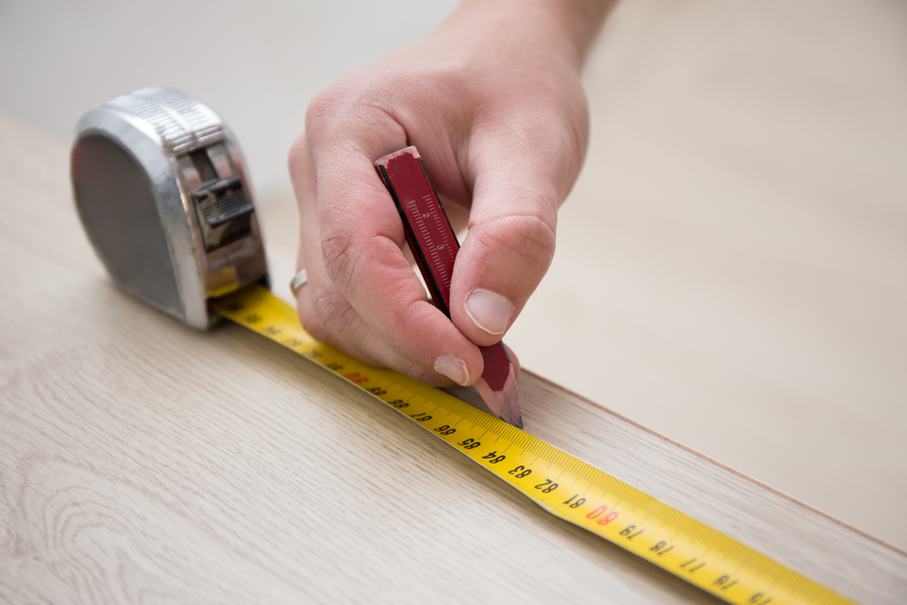measuring to lay a solid wood floor