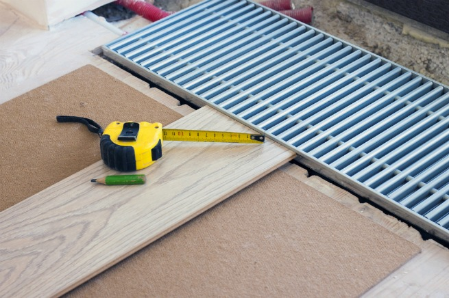 image of laminate flooring being fitted to prevent laminate flooring lifting