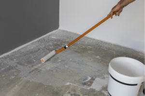 Laying primer on concrete floor